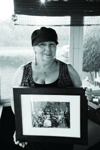 Donna Miles with Photo of Her Family